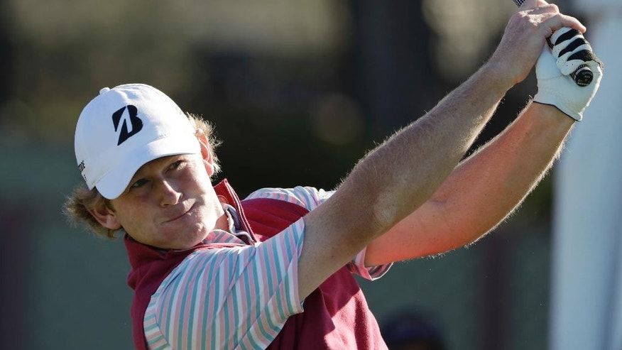 Brandt Snedeker watches his tee shot on the first hole of the South Course during the third round of the Farmers Insurance Open golf tournament Saturday, Jan. 28, 2017, at Torrey Pines Golf Course in San Diego. (AP Photo/Gregory Bull)