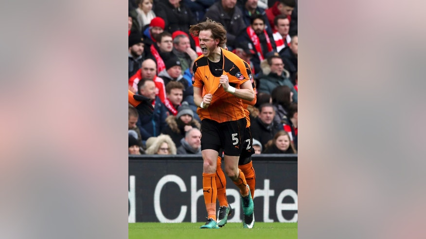 Wolverhampton Wanderers' Richard Stearman, celebrates scoring his side's first goal of the game with his team-mates during the English FA Cup, fourth round match Liverpool vs Wolverhampton Wanderers at Anfield, Liverpool, England, Saturday Jan. 28, 2017. (Peter Byrne/PA via AP)