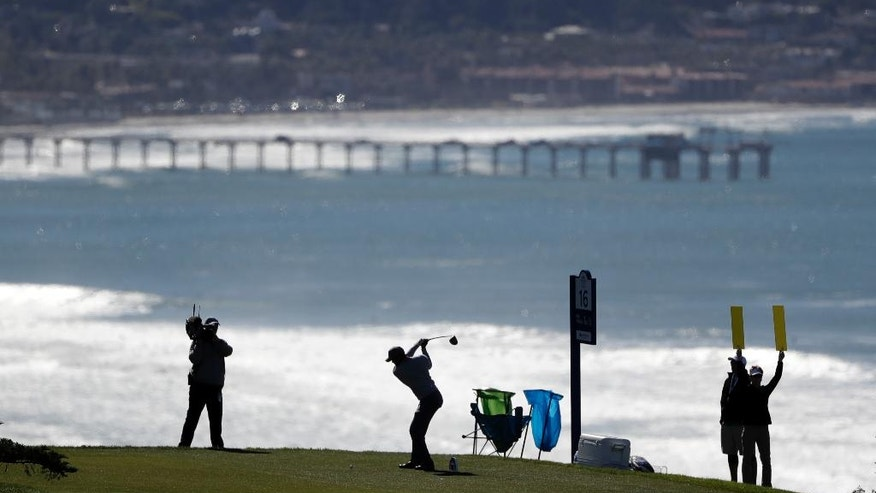 Tiger Woods hits his tee shot on the 16th hole of the north course during the second round of the Farmers Insurance Open golf tournament Friday, Jan. 27, 2017, at Torrey Pines Golf Course in San Diego. (AP Photo/Gregory Bull)