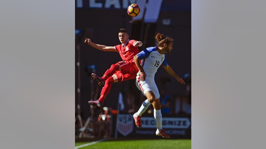 Serbia's Srdan Plavsic, left, fights for the ball with United States' Graham Zuzi, right, during a friendly soccer match Sunday, Jan. 29, 2017, in San Diego. (AP Photo/Denis Poroy)