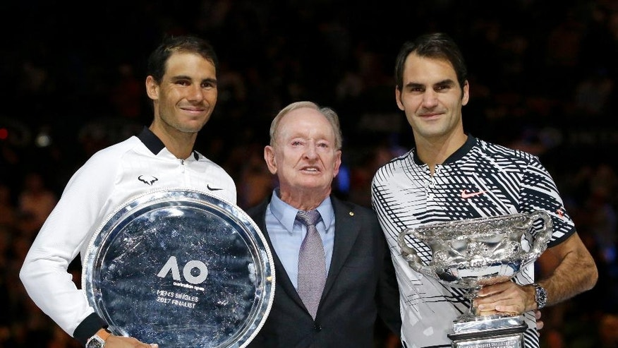 Switzerland's Roger Federer, right, Spain's Rafael Nadal, left, and Rod Laver pose for photographers after Federer won the men's singles final at the Australian Open tennis championships in Melbourne, Australia, Sunday, Jan. 29, 2017. (AP Photo/Aaron Favila)