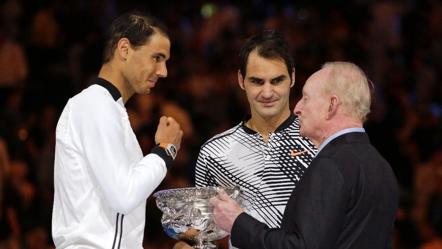 Switzerland's Roger Federer, center, Spain's Rafael Nadal, left, and Rod Laver chat during the trophy presentation after Federer won their men's singles final at the Australian Open tennis championships in Melbourne, Australia, Sunday, Jan. 29, 2017. (AP Photo/Aaron Favila)