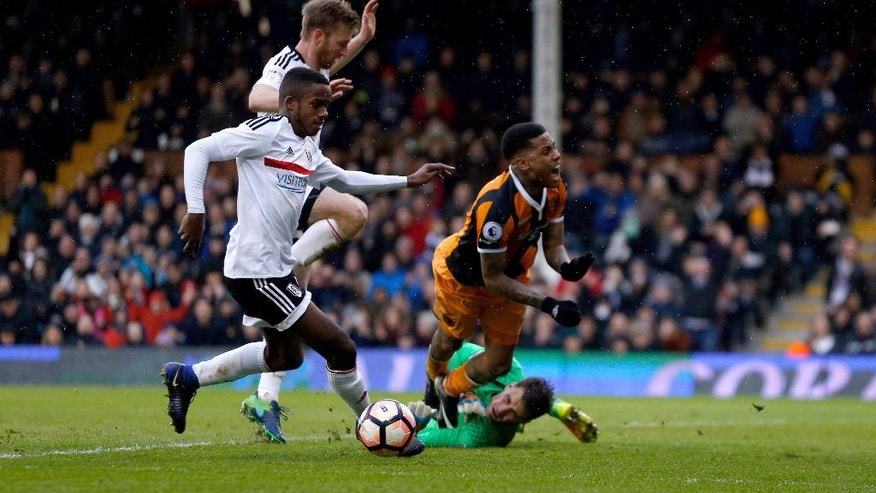 Hull City's Abel Hernandez wins a second penalty after being brought down by Fulham goalkeeper Marcus Bettinelli during the English FA Cup, Fourth Round match, Fulham vs Hull City at Craven Cottage, London, Sunday Jan. 29, 2017. (Paul Harding/PA via AP)