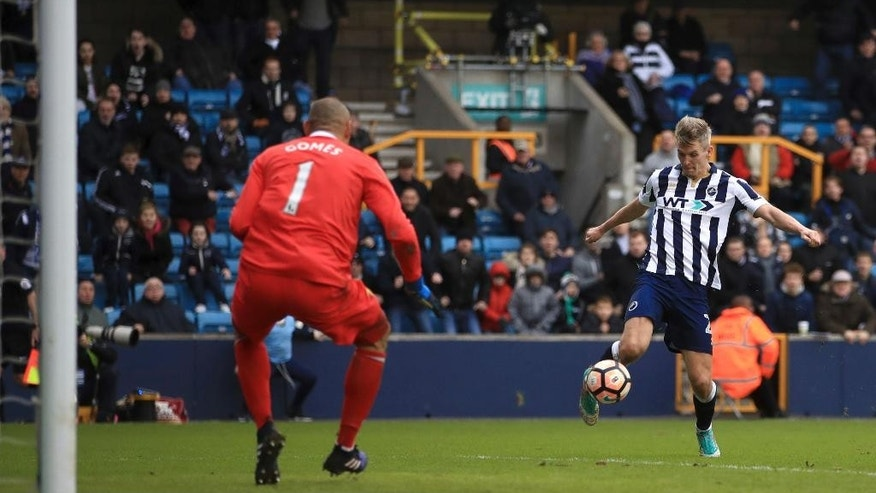 Millwall's Steve Morison scores his side's first goal of the game during the English FA Cup, Fourth Round soccer match, Millwall vs Watford at The Den, London, Sunday, Jan. 29, 2017. (John Walton/PA via AP)