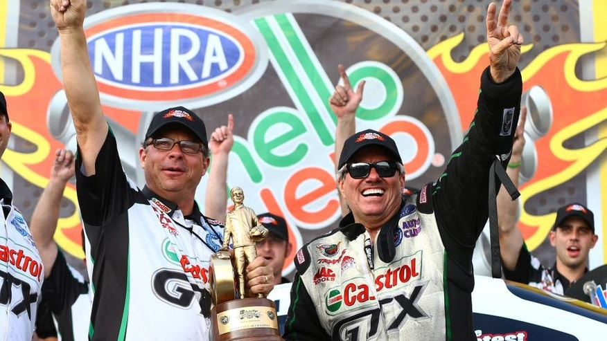 Oct 6, 2013; Mohnton, PA, USA; NHRA funny car driver John Force (right) celebrates with crew chief Jimmy Prock after winning the Auto Plus Nationals at Maple Grove Raceway. Mandatory Credit: Mark J. Rebilas-USA TODAY Sports