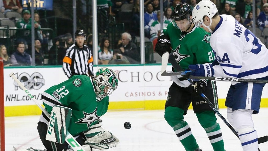 Dallas Stars goalie Kari Lehtonen (32) and defenseman Esa Lindell (23) keep Toronto Maple Leafs center Auston Matthews (34) away from the puck during the second period of an NHL hockey game in Dallas, Tuesday, Jan. 31, 2017. (AP Photo/LM Otero)