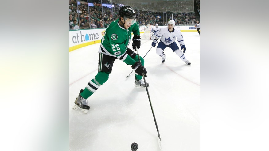 Dallas Stars right wing Brett Ritchie (25) skates for the puck against Toronto Maple Leafs defenseman Matt Hunwick (2) during the first period of an NHL hockey game in Dallas, Tuesday, Jan. 31, 2017. (AP Photo/LM Otero)