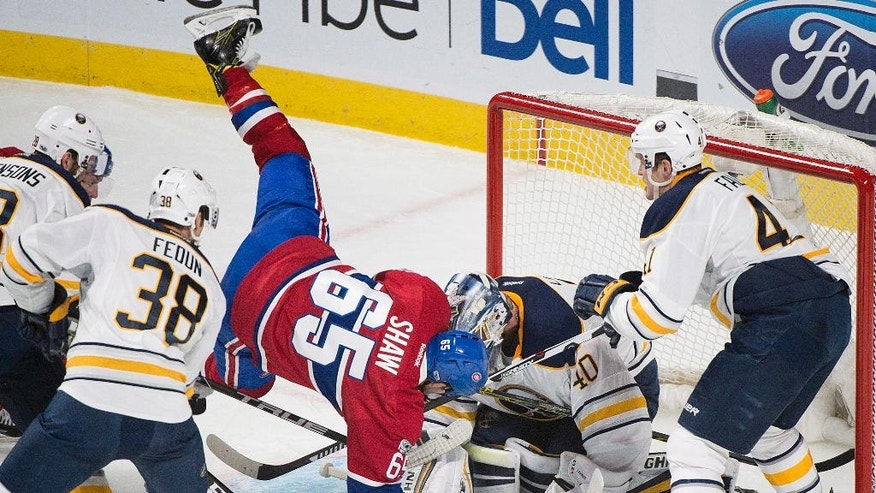 Montreal Canadiens' Andrew Shaw collides wit Buffalo Sabres goaltender Robin Lehner as Sabres' Justin Falk (41) and Taylor Fedun (38) defend during second period NHL hockey action in Montreal, Tuesday, Jan. 31, 2017. (Graham Hughes/The Canadian Press via AP