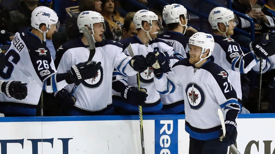 Winnipeg Jets' Nikolaj Ehlers, of Denmark, is congratulated by teammates after scoring during the second period of an NHL hockey game against the St. Louis Blues Tuesday, Jan. 31, 2017, in St. Louis. (AP Photo/Jeff Roberson)