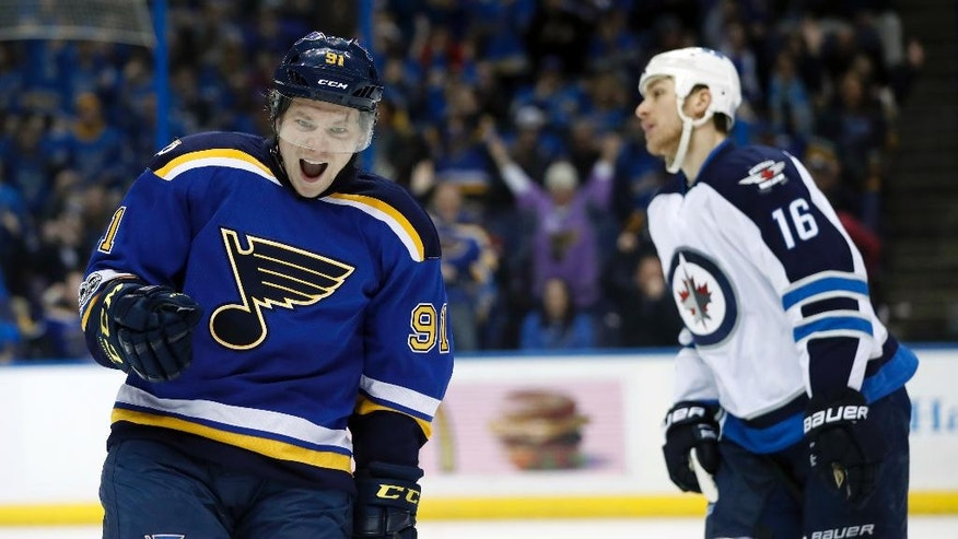 St. Louis Blues' Vladimir Tarasenko, of Russia, celebrates after scoring as Winnipeg Jets' Shawn Matthias (16) skates past during the second period of an NHL hockey game Tuesday, Jan. 31, 2017, in St. Louis. (AP Photo/Jeff Roberson)