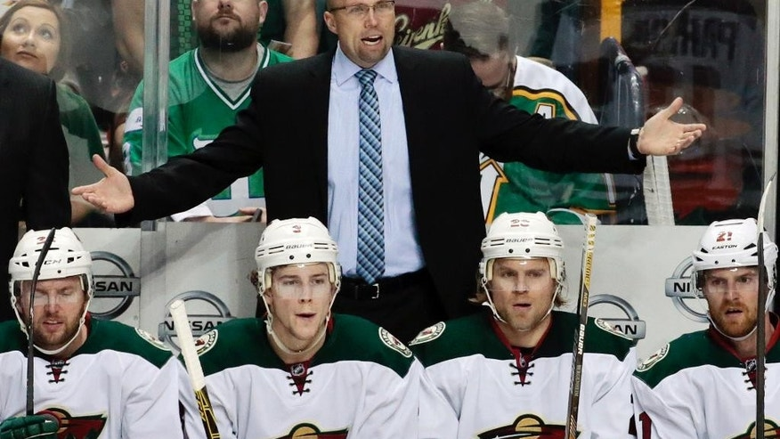 FILE - In this March 17, 2015 file photo, Minnesota Wild head coach Mike Yeo argues a call in the second period of an NHL hockey game against the Nashville Predators  in Nashville, Tenn. The St. Louis Blues have fired coach Ken Hitchcock. Assistant and coach-in-waiting Mike Yeo replaced him. Yeo was supposed to succeed Hitchcock after this season, the veteran coach's final season in St. Louis. General manager Doug Armstrong announced the change Wednesday, Feb. 1, 2017.  (AP Photo/Mark Humphrey)