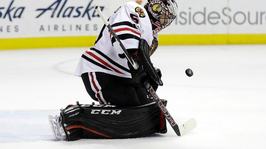 Chicago Blackhawks goalie Corey Crawford stops as shot against the San Jose Sharks during the second period of an NHL hockey game Tuesday, Jan. 31, 2017, in San Jose, Calif. (AP Photo/Marcio Jose Sanchez)