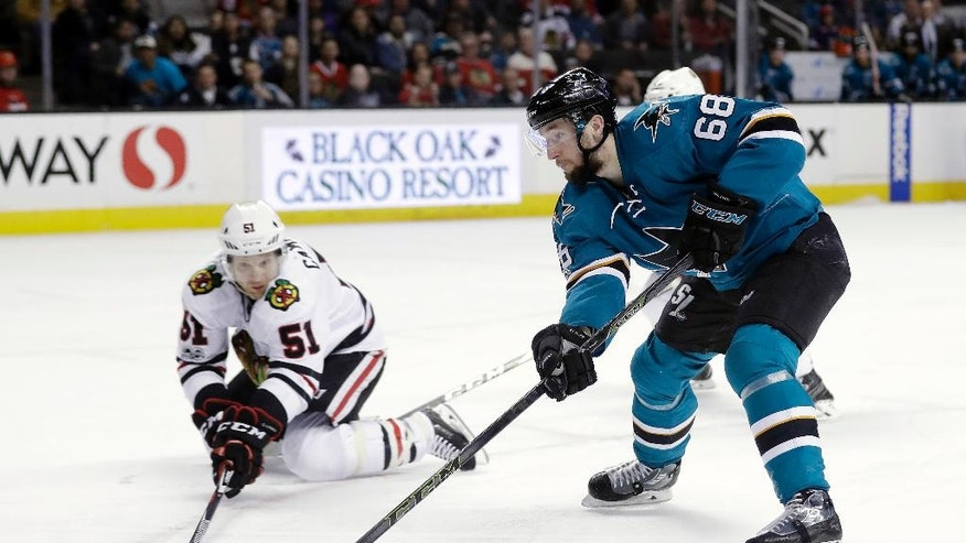 San Jose Sharks' Melker Karlsson (68) works with the puck as Chicago Blackhawks' Brian Campbell (51) defends during the second period of an NHL hockey game Tuesday, Jan. 31, 2017, in San Jose, Calif. (AP Photo/Marcio Jose Sanchez)
