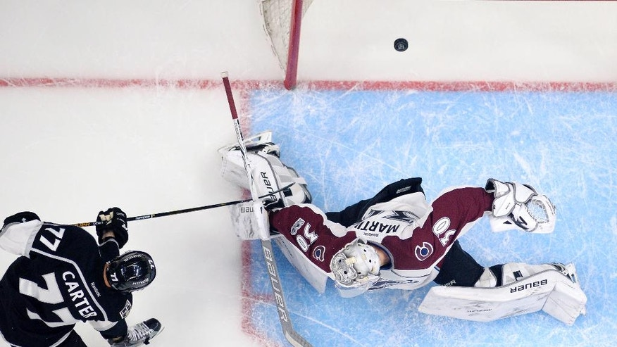 Los Angeles Kings center Jeff Carter, left, scores on Colorado Avalanche goalie Spencer Martin during the first period of an NHL hockey game, Wednesday, Feb. 1, 2017, in Los Angeles. (AP Photo/Mark J. Terrill)