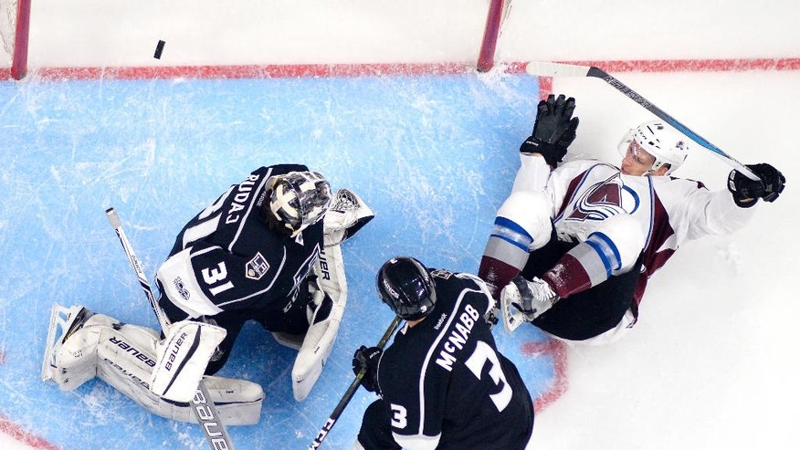 Colorado Avalanche left wing Blake Comeau, right, trips over Los Angeles Kings goalie Peter Budaj, left, of Slovakia, as Kings defenseman Brayden McNabb watches during the second period of an NHL hockey game, Wednesday, Feb. 1, 2017, in Los Angeles. The puck crossed the line on the play, but was called back for goalie interference. (AP Photo/Mark J. Terrill)