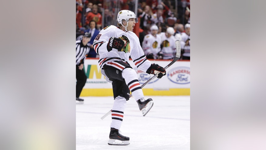 Chicago Blackhawks right wing Patrick Kane celebrates after scoring in the first period during an NHL hockey game against the Arizona Coyotes, Thursday, Feb. 2, 2017, in Glendale, Ariz. (AP Photo/Rick Scuteri)