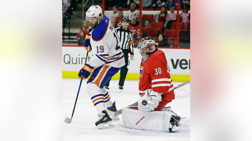 Carolina Hurricanes goalie Cam Ward (30) blocks Edmonton Oilers' Patrick Maroon (19) during the first period of an NHL hockey game in Raleigh, N.C., Friday, Feb. 3, 2017. (AP Photo/Gerry Broome)