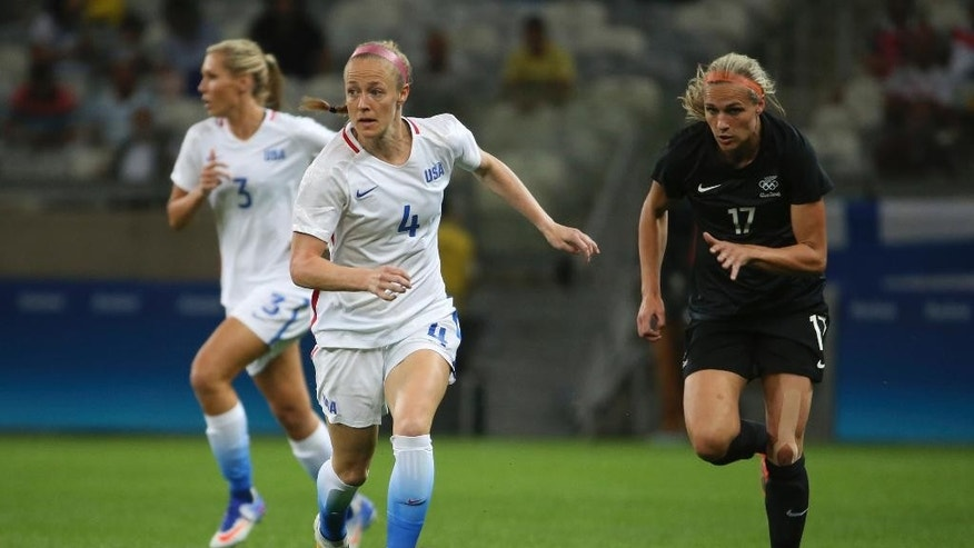 FILE - In this Aug. 3, 2016 file photo, United States' Becky Sauerbrunn, left, dribbles the ball past New Zealand's Hannah Wilkinson, right, during a women's Olympic football tournament match at the Mineirao stadium in Belo Horizonte, Brazil.  An emphasis on player-driven leadership has brought encouraging signs in talks for a labor contract between the women's national team and the U.S. Soccer Federation, according to Sauerbrunn. (AP Photo/Eugenio Savio)
