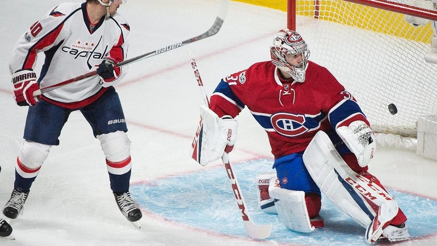 Montreal Canadiens goaltender Carey Price is scored on by Washington Capitals' Nicklas Backstrom as Capitals Marcus Johansson, left, looks for a rebound during third period NHL hockey action in Montreal, Saturday, Feb. 4, 2017. (Graham Hughes/The Canadian Press via AP)