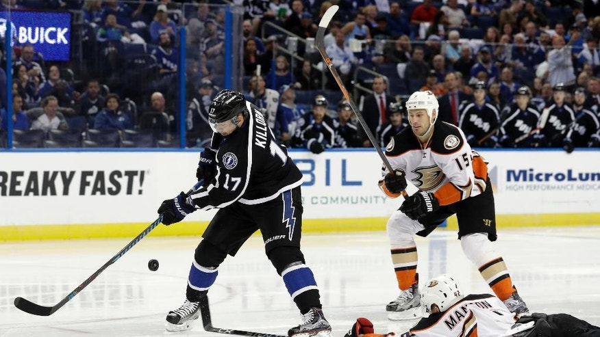 Anaheim Ducks defenseman Josh Manson (42) dives and knocks the puck away from Tampa Bay Lightning left wing Alex Killorn (17) during the second period of an NHL hockey game Saturday, Feb. 4, 2017, in Tampa, Fla. Trailing the play is Ducks' Ryan Getzlaf. (AP Photo/Chris O'Meara)