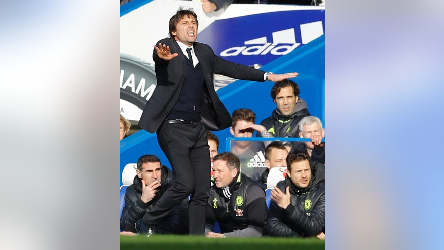 Chelsea's manager Antonio Conte gestures to his team during the English Premier League soccer match between Chelsea and Arsenal at Stamford Bridge stadium in London, Saturday, Feb. 4, 2017. (AP Photo/Frank Augstein)