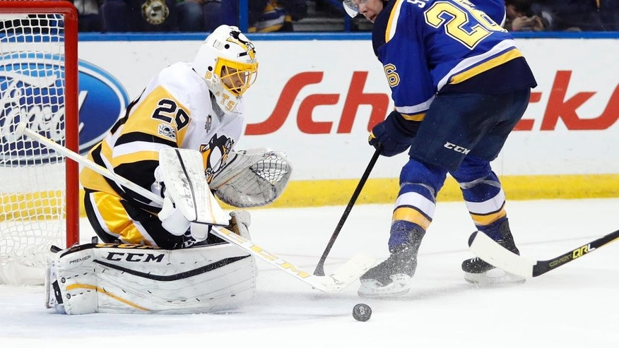 Pittsburgh Penguins goalie Marc-Andre Fleury, left, turns away a shot from St. Louis Blues' Paul Stastny during the second period of an NHL hockey game Saturday, Feb. 4, 2017, in St. Louis. (AP Photo/Jeff Roberson)