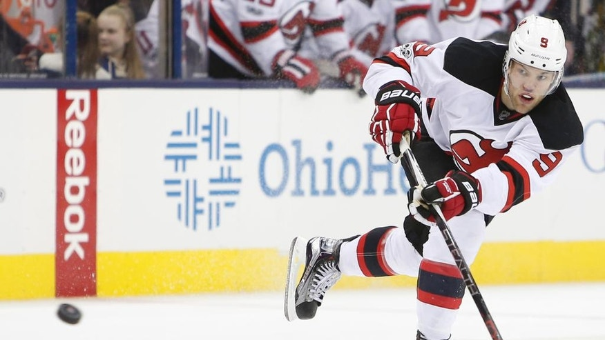 New Jersey Devils' Taylor Hall scores an open net goal against the Columbus Blue Jackets during the third period of an NHL hockey game Saturday, Feb. 4, 2017, in Columbus, Ohio. The Devils beat the Blue Jackets 5-1. (AP Photo/Jay LaPrete)