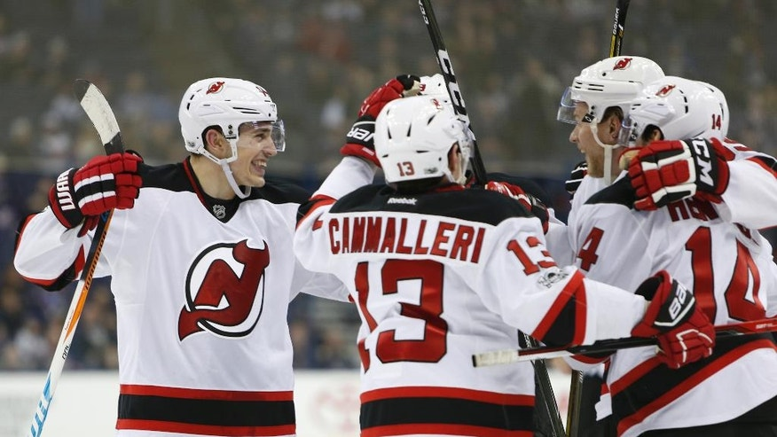 New Jersey Devils' Miles Wood, left, celebrates their goal against the Columbus Blue Jackets with teammates during the third period of an NHL hockey game Saturday, Feb. 4, 2017, in Columbus, Ohio. The Devils beat the Blue Jackets 5-1. (AP Photo/Jay LaPrete)