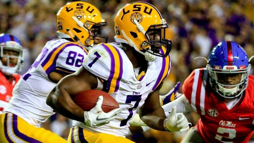 Oct 22, 2016; Baton Rouge, LA, USA; LSU Tigers running back Leonard Fournette (7) runs for a touchdown against the Mississippi Rebels during the second quarter of a game at Tiger Stadium. Mandatory Credit: Derick E. Hingle-USA TODAY Sports