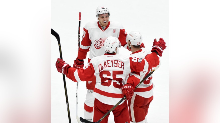 Detroit Red Wings' Anthony Mantha (39), Danny DeKeyser (65) and Mike Green, right, celebrate after Green scored a goal against the Nashville Predators during the first period of an NHL hockey game Saturday, Feb. 4, 2017, in Nashville, Tenn. (AP Photo/Mark Zaleski)