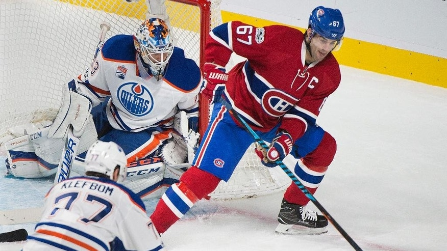Montreal Canadiens' Max Pacioretty moves in on Edmonton Oilers goaltender Cam Talbot as Oilers' Oscar Klefbom (77) defends during the second period of an NHL hockey game in Montreal on Sunday, Feb. 5, 2017. (Graham Hughes/The Canadian Press via AP)
