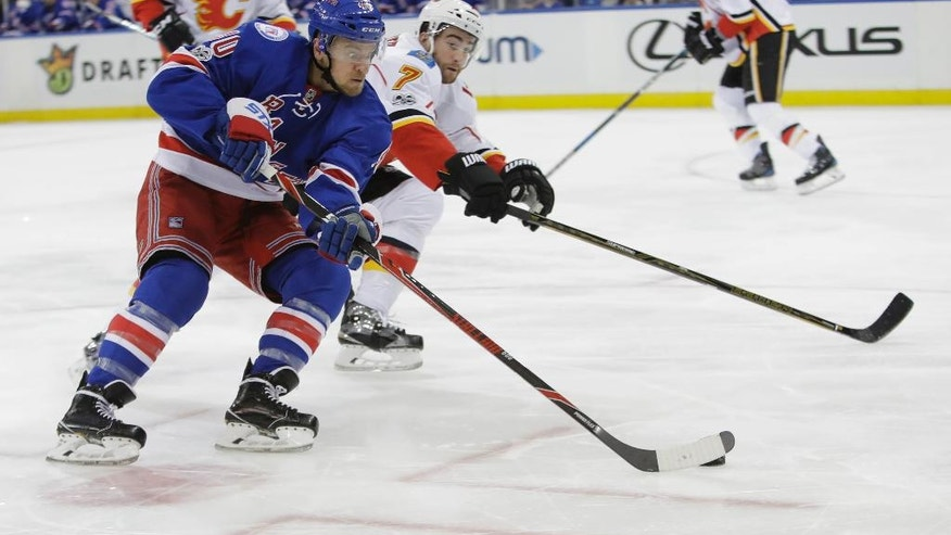 New York Rangers' Michael Grabner (40) is defended by Calgary Flames' TJ Brodie (7) during the second period of an NHL hockey game Sunday, Feb. 5, 2017, in New York. (AP Photo/Frank Franklin II)