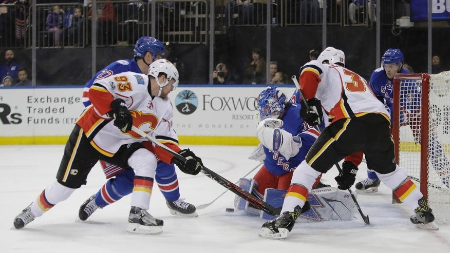 New York Rangers goalie Henrik Lundqvist (30), of Sweden, stops a shot on goal by Calgary Flames' Sam Bennett (93) during the first period of an NHL hockey game Sunday, Feb. 5, 2017, in New York. (AP Photo/Frank Franklin II)