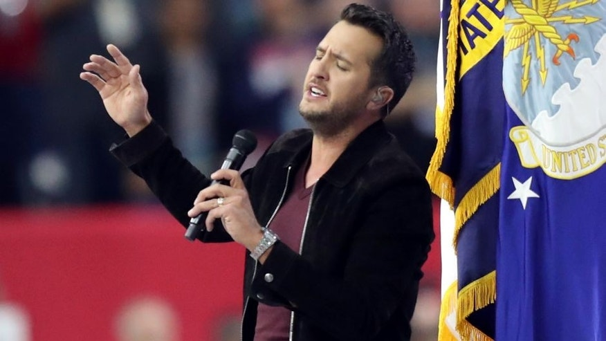 Feb 5, 2017; Houston, TX, USA; Luke Bryan sings the National Anthem prior to Super Bowl LI between the Atlanta Falcons and the New England Patriots at NRG Stadium. Mandatory Credit: Kevin Jairaj-USA TODAY Sports