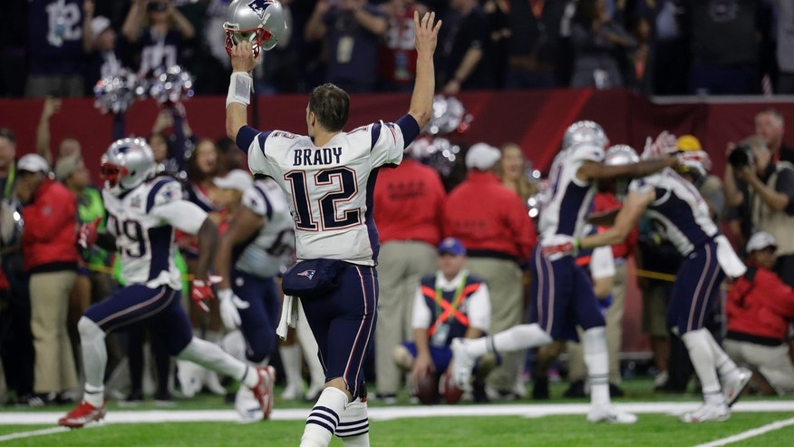 Feb. 5, 2017: New England Patriots quarterback Tom Brady reacts after winning Super Bowl 51 against the Atlanta Falcons in overtime in Houston.