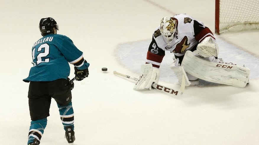 Arizona Coyotes goalie Mike Smith (41) blocks a shot attempt by San Jose Sharks center Patrick Marleau (12) during a shootout in an NHL hockey game in San Jose, Calif., Saturday, Feb. 4, 2017. The Coyotes won in a shootout, 3-2. (AP Photo/Jeff Chiu)