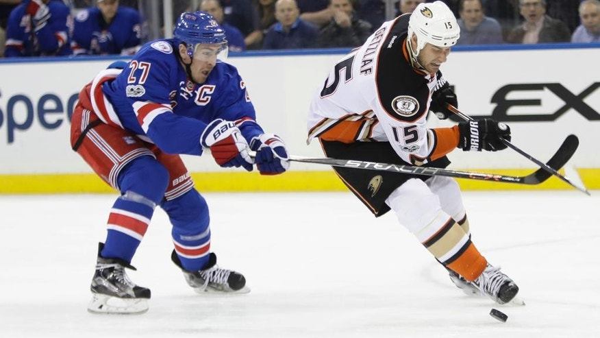 Anaheim Ducks' Ryan Getzlaf (15) drives past New York Rangers' Ryan McDonagh (27) during the first period of an NHL hockey game Tuesday, Feb. 7, 2017, in New York. (AP Photo/Frank Franklin II)