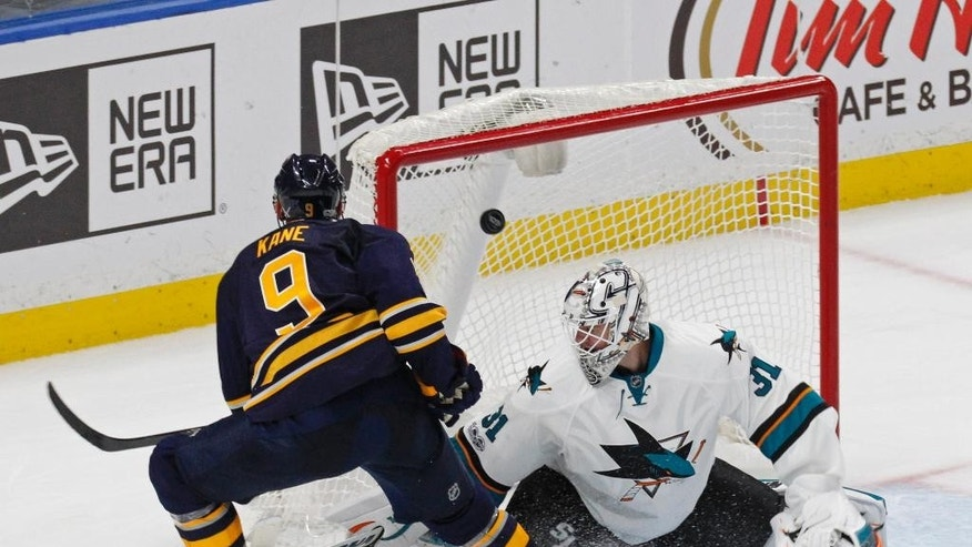 Buffalo Sabres forward Evander Kane (9) puts the puck past San Jose Sharks goalie Martin Jones (31) to win the game in the overtime period of an NHL hockey game, Tuesday, Feb. 7, 2017, in Buffalo, N.Y. (AP Photo/Jeffrey T. Barnes)