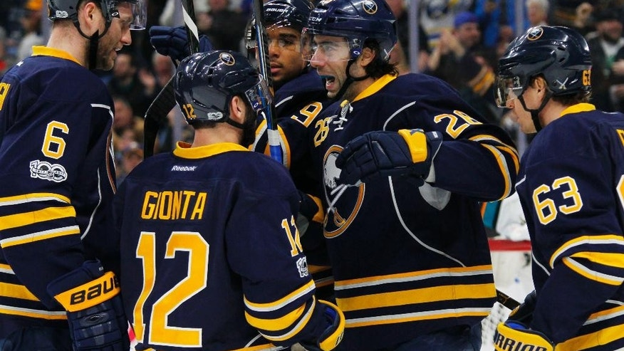 Buffalo Sabres forward Matt Moulson (26) celebrates his goal with teammates during the first period of an NHL hockey game against the San Jose Sharks, Tuesday, Feb. 7, 2017, in Buffalo, N.Y. (AP Photo/Jeffrey T. Barnes)