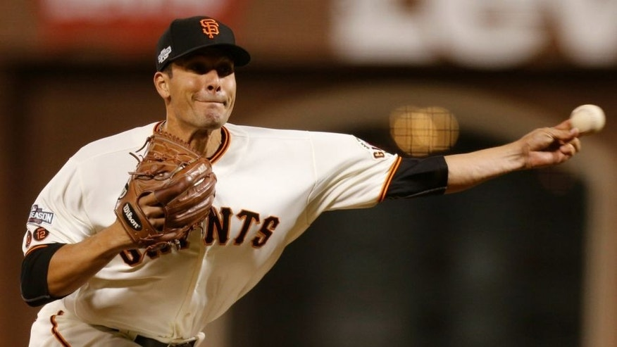 Oct 11, 2016; San Francisco, CA, USA; San Francisco Giants relief pitcher Javier Lopez (49) delivers a pitch during the ninth inning of game four of the 2016 NLDS playoff baseball game against the Chicago Cubs at AT&T Park. Mandatory Credit: John Hefti-USA TODAY Sports