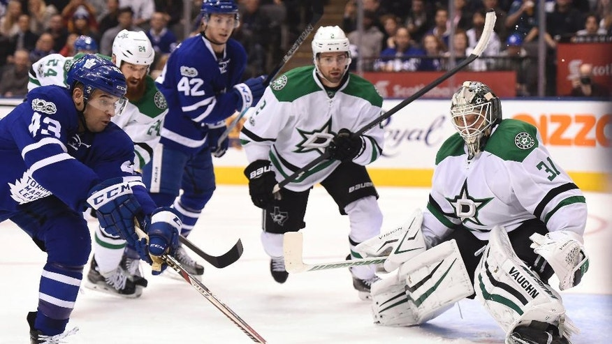 Dallas Stars goalie Antti Niemi (31) watches the puck as Toronto Maple Leafs center Nazem Kadri (43) pounces on a rebound during second period NHL hockey action in Toronto on Tuesday, Feb. 7, 2017. (Frank Gunn/The Canadian Press via AP)