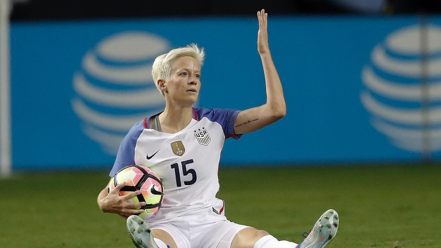 FILE - In this Sept. 18, 2016, file photo, USA's Megan Rapinoe reacts in the second half of an exhibition soccer match against Netherlands in Atlanta. Rapinoe has been left off the U.S. roster for a training camp ahead of the SheBelieves Cup tournament. (AP Photo/John Bazemore, File)