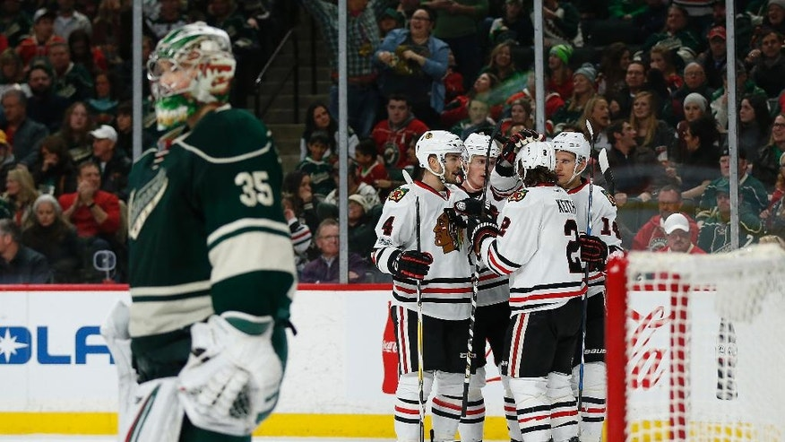 Chicago Blackhawks teammates celebrate after scoring a third goal in the second period of an NHL hockey game against the Minnesota Wild, Wednesday, Feb. 8, 2017, in St. Paul, Minn. (AP Photo/Stacy Bengs)