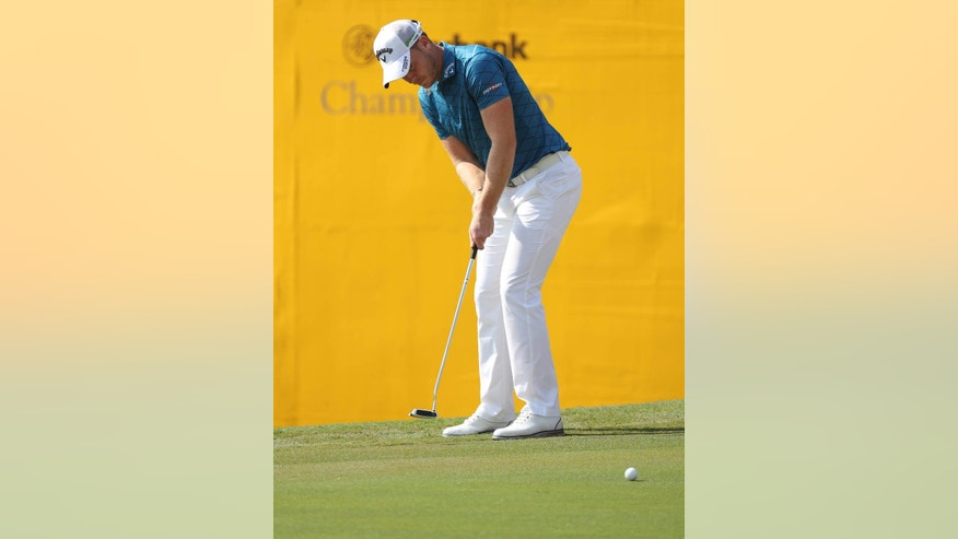 Danny Willet of England plays a putt on the eighteenth hole during the first day of the Maybank Championship golf tournament in Kuala Lumpur, Malaysia, on Thursday, Feb. 9, 2017. (AP Photo/Vincent Thian)