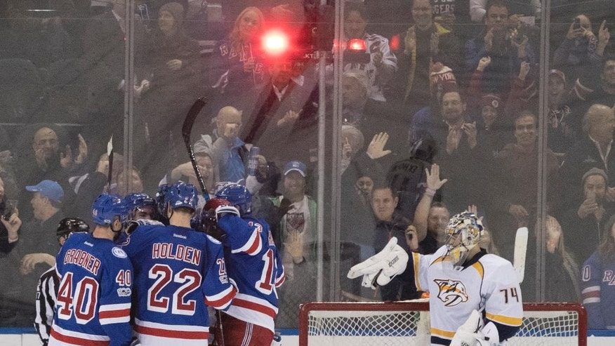 Nashville Predators goalie Juuse Saros (74) reacts as New York Rangers players celebrate a goal during the third period of an NHL hockey game, Thursday, Feb. 9, 2017, at Madison Square Garden in New York. (AP Photo/Mary Altaffer)