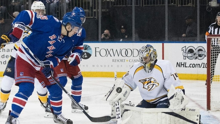 Nashville Predators goalie Juuse Saros (74) blocks a shot at the goal by New York Rangers left wing Jimmy Vesey (26) during the second period of an NHL hockey game, Thursday, Feb. 9, 2017, at Madison Square Garden in New York. (AP Photo/Mary Altaffer)