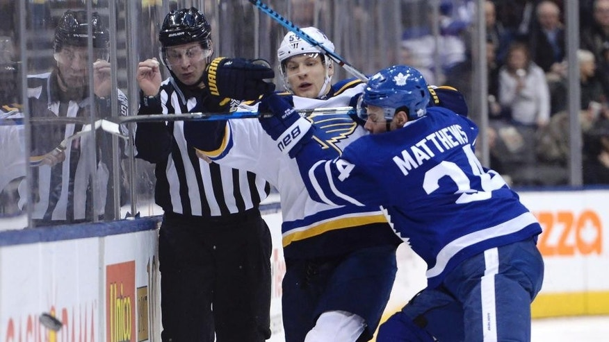 Toronto Maple Leafs center Auston Matthews (34) hits St. Louis Blues defenseman Colton Parayko (55) during the third period of an NHL hockey game Thursday, Feb. 9, 2017, in Toronto. (Nathan Denette/The Canadian Press via AP)