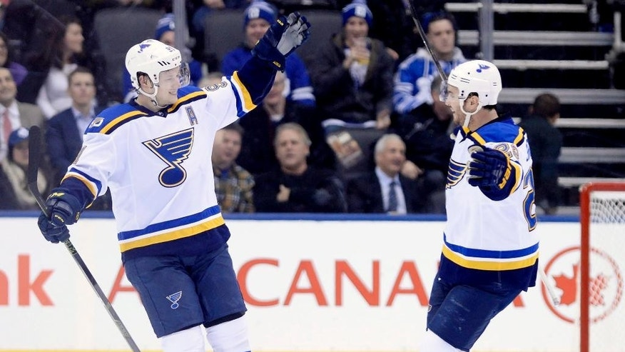 St. Louis Blues right wing Vladimir Tarasenko (91) celebrates his game winning-goal with defenseman Kevin Shattenkirk (22) after scoring against the Toronto Maple Leafs during overtime of an NHL hockey game Thursday, Feb. 9, 2017, in Toronto. (Nathan Denette/The Canadian Press via AP)