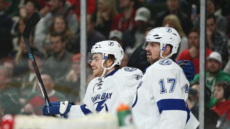Tampa Bay Lightning's Brayden Point, left, smiles with teammate Alex Killorn (17) after Point scored the Lightning's first goal in the second period of an NHL hockey game against the Minnesota Wild, Friday, Feb. 10, 2017, in St. Paul, Minn. (AP Photo/Stacy Bengs)