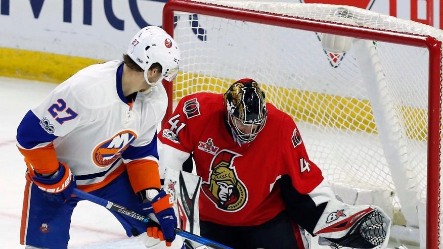 Ottawa Senators goalie Craig Anderson (41) makes a save on New York Islanders left wing Anders Lee (27) during the third period of an NHL hockey game in Ottawa, Saturday Feb. 11, 2017. (Fred Chartrand/The Canadian Press via AP)